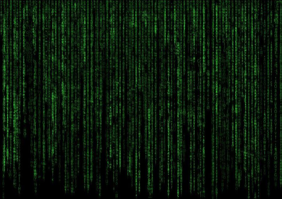 Grön datakod böljar ner över svart bildskärm